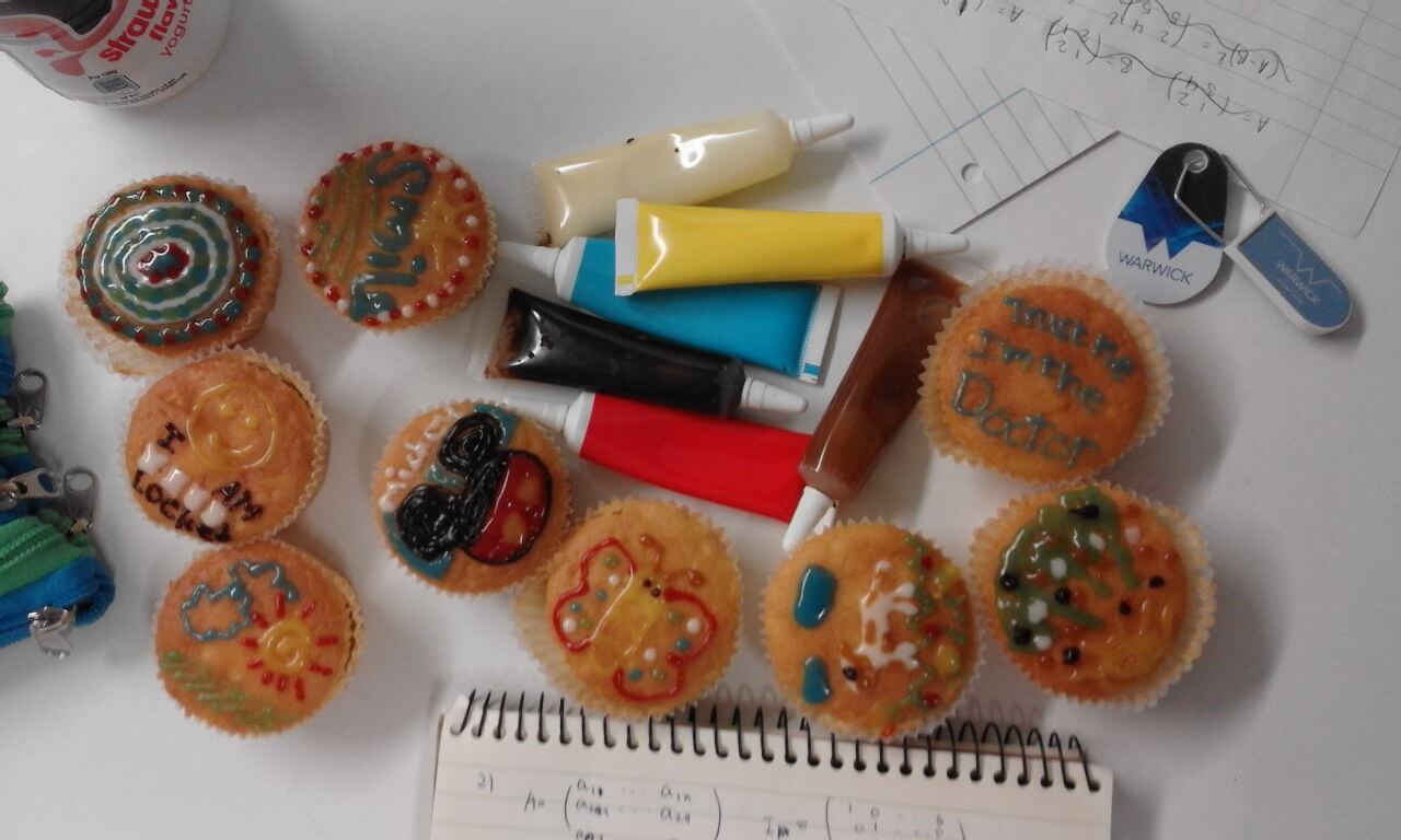 A picture of the cakes my flat-mates and I decorated.
